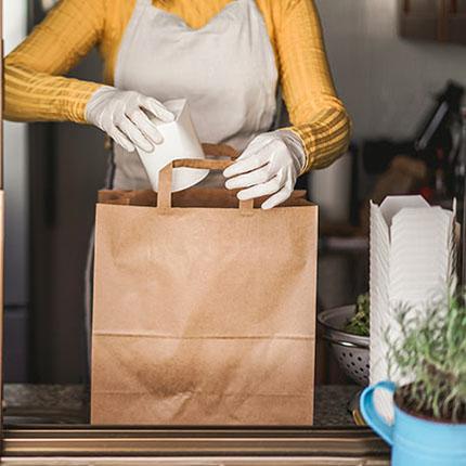 Employee bagging items