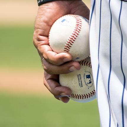 player holding baseballs