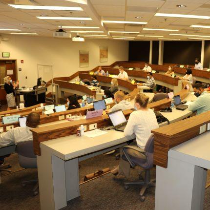 EMBA students in de-densified classroom