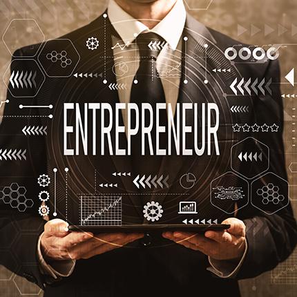 Man holding entrepreneur sign